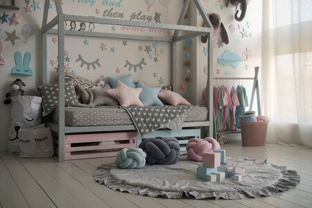 Interior of a children's room with a cradle and toys. Pastel colors, modern design.