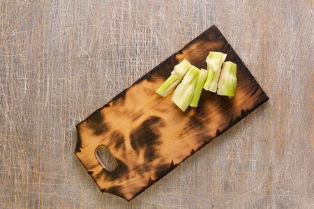 Celery stalks on a cutting board Stock Photo