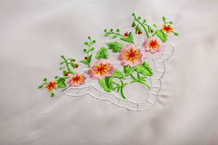 White tablecloth with embroidered flowers 스톡 콘텐츠
