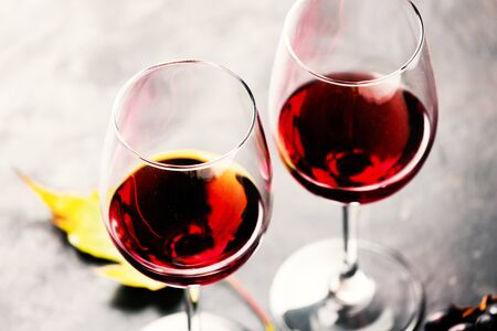 Autumn wine. Red wine in glasses, close-up