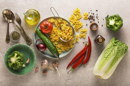 Vegetarian background. Vegetarian food menu. Ingredients vegetable salad and a side dish of pasta. 版權商用圖片