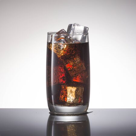 Cola with ice, close-up. Soft non-alcoholic cocktail Stock Photo