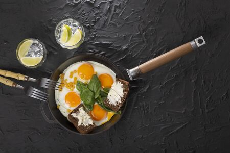 Healthy breakfast. Fried eggs and bread and butter Stock Photo