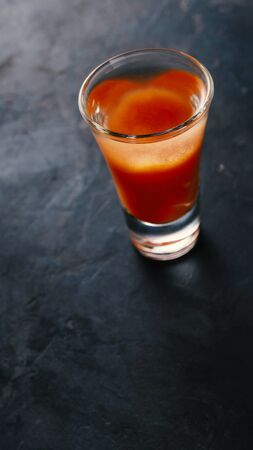 Bloody mary cocktail on a concrete dark table