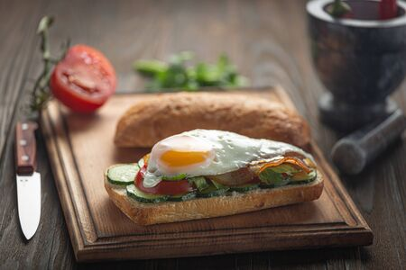 Juicy egg and ham sandwich for breakfast