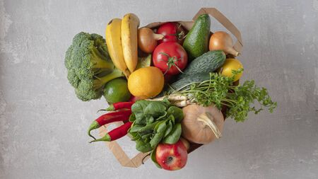 A grocery bag full of organic products. Top view, eco friendly shop.