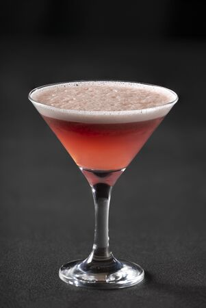 Classic Clover Club cocktail in a cocktail glass on a dark background. Stock Photo