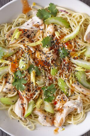 Ramen noodles with chicken and celery closeup, top view Stock Photo