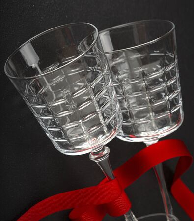 Champagne glasses with red ribbon. Wedding, Date, Valentines Day