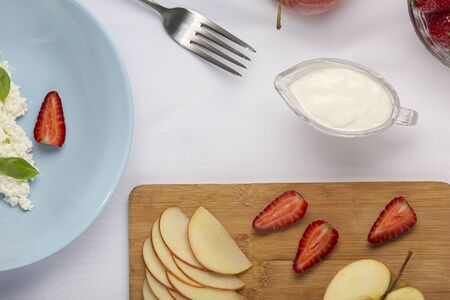 Healthy breakfast or snack. Fruits, cottage cheese. strawberries apples