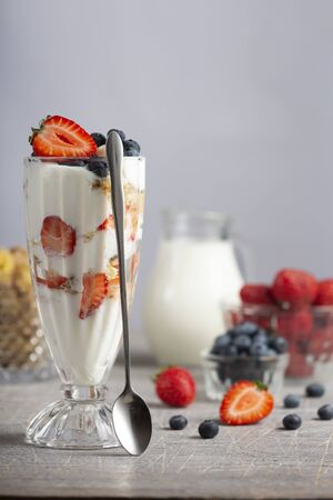 Cooking cream dessert with strawberry and blueberry