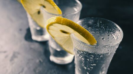 Tequila, vodka, gin. Alcohol in glasses. Chilled alcoholic drink misted takan