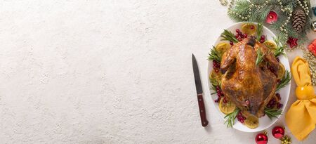 banner Christmas table with baked turkey or chicken, copy space for text. Christmas dinner Stock Photo