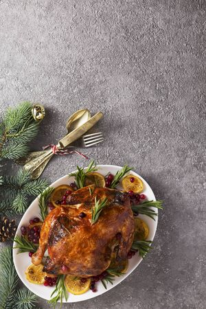 Christmas table with baked turkey or chicken, copy space for text. Christmas dinner, top view
