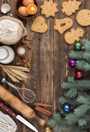 christmas baking background culinary background with spices and Christmas winter ingredients for baking on a vintage wooden table. Top view with copy space.