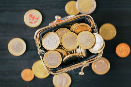 Euro coins in a wallet, top view. concept of small money, the financial crisis, the consequences of quarantine Covid-19