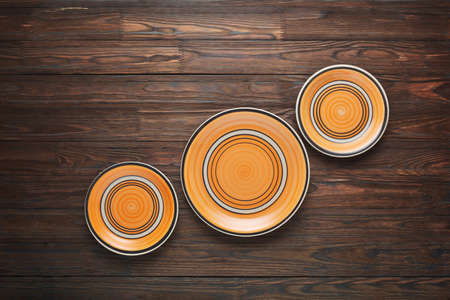 Rustic handmade plates on wooden boards.