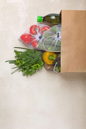 Paper bag vegetables delivery from supermarket. Fresh vegetables and herbs, order delivery via the Internet