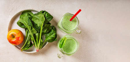 Spinach and yogurt smoothie with apple. Juicy spinach leaves and ripe red apple. Healthy eating, top view