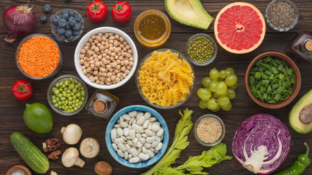 set of products balanced nutrition legumes, vegetables, herbs, fruits, top view Archivio Fotografico
