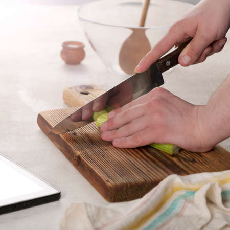 knife cutting, vegetable salad, restaurant kitchen, young caucasian, cutting board, knife cuts, young man, healthy meal