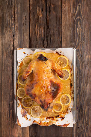 Chicken or duck baked in oven on festive dinner table, top view Archivio Fotografico