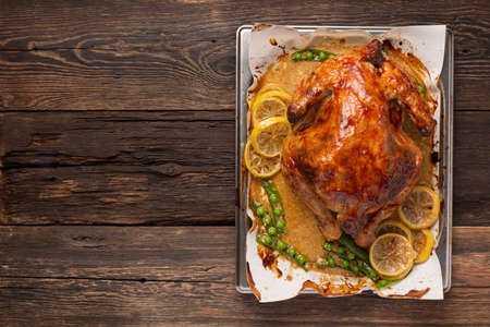 Chicken or duck baked in oven on festive dinner table,top view