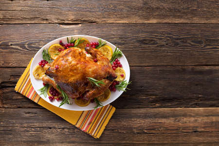 Thanksgiving chicken on wooden table gala dinner,top view Archivio Fotografico