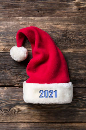 Santa Claus hat on a wooden background. Christmas, New Year