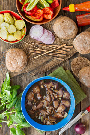 Set of products for cooking burgers. Cooking burgers with vegetables and meat on a wooden table, top view Archivio Fotografico - 156345100