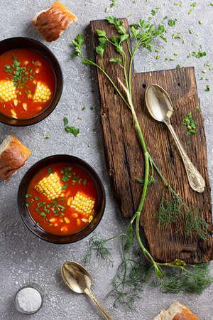 Tomato corn soup on dining table 版權商用圖片