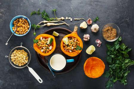 Vegetarian food hokkaido pumpkin with chickpeas and herbs, top view