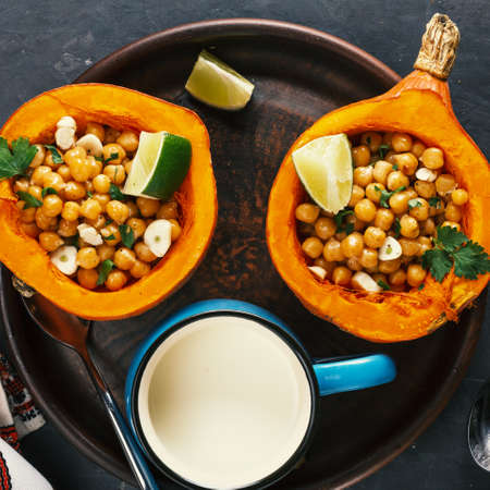 Vegetarian food hokkaido pumpkin with chickpeas and herbs, close up