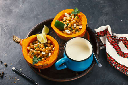 baked hokkaido pumpkin with chickpeas with chickpeas diet food, close up Archivio Fotografico - 156785797