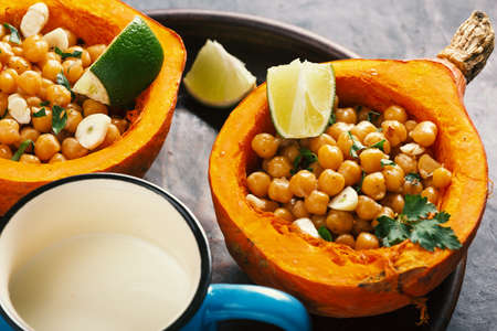 baked hokkaido pumpkin with chickpeas with chickpeas diet food, close up
