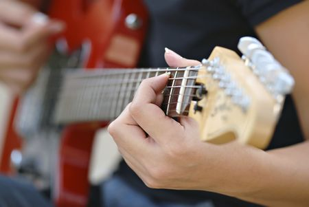 Close up of guitarist hand playing the guitar. Stock Photo