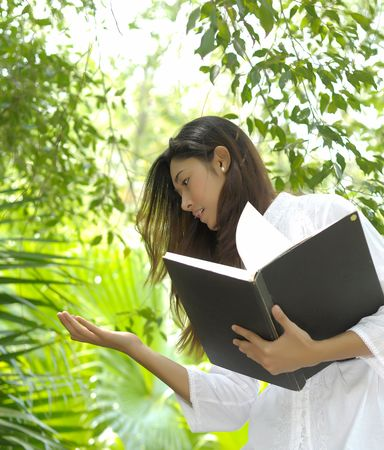 asian school girl: A pretty college girl study on leaves for bio technology  Stock Photo