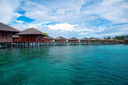 Exotic tropical resort in the middle of ocean on crystal clear water
