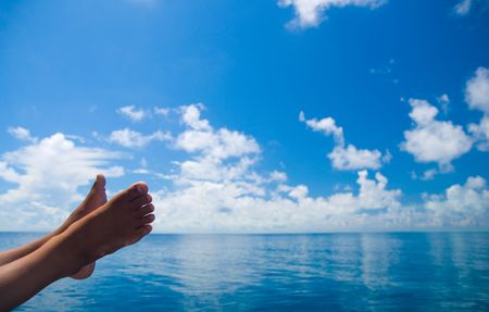 The boy's leg on boat during vacation Stock Photo - 5318581