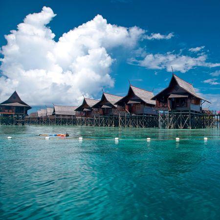 resort life: A man-made walkway Kapalai island with exotic tropical resort