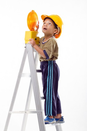 Little plays as a construction worker photo