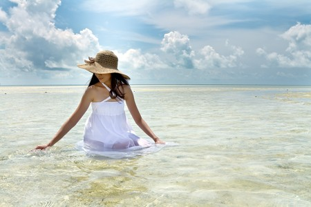 Asian pretty girl during holiday at beautiful ocean photo