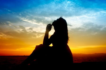 Silhouette of young sensuality beautiful woman during sunset