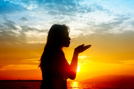 Silhouette of young sensuality beautiful woman during sunset photo