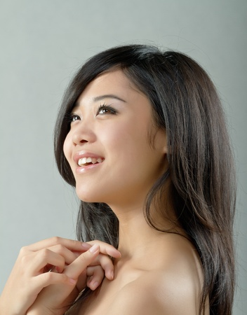 top: Portrait of attractive woman, happy and smiling. Stock Photo
