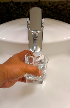 pureness: filling a glass of fresh water from water tap Stock Photo