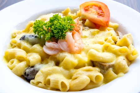 Prawn macaroni pasta with cheese and mushrooms