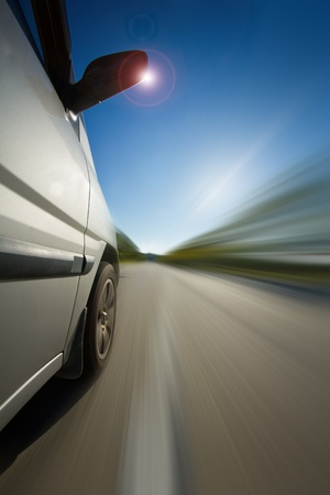 Fast moving car in high speed with motion blur effect Stock Photo - 12923098