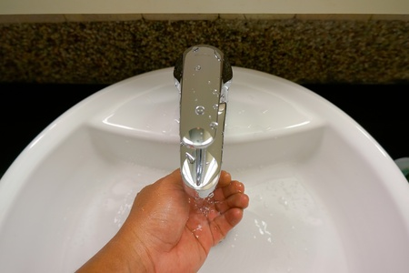 wash hand from water tap Stock Photo