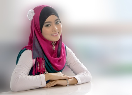 malay ethnicity: Beautiful young Asian Muslim woman with lovely smiles